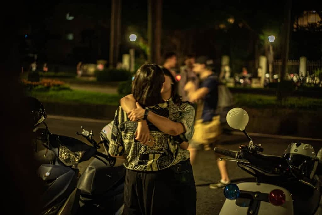 Two Taiwanese girls kissing at the end of the Taipei pride 2019